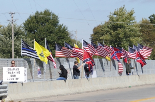 Flags and signs at an anti-Obama demonstration on an overpass over U.S Highway 50 in Warrensburg, Missouri - October 10, 2015.