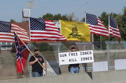 Mixed messages? Anti-Obama demonstration on an overpass over U.S. Highway 50 in Warrensburg, Missouri - October 10, 2015.