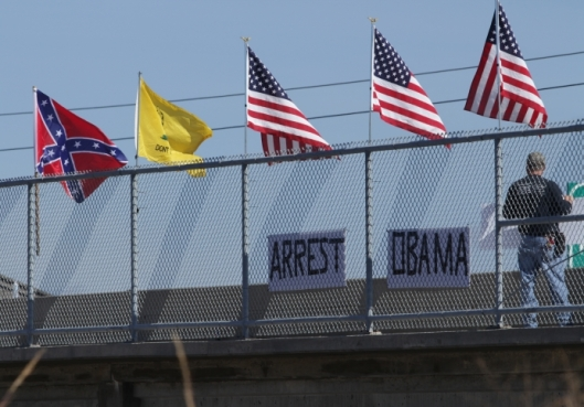 Anti-Obama demonstration on an overpass over U.S. Highway 50 in Warrensburg, Missouri - October 10, 2015.
