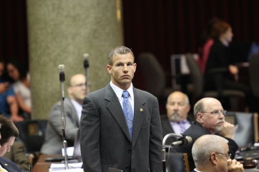 Representative Rick Brattin (r) on the House floor [2013 file photo].