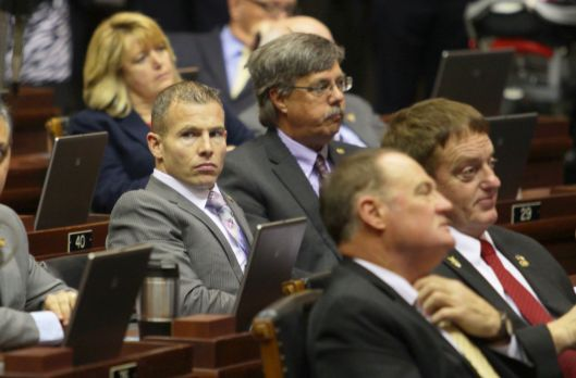 Representative Rick Brattin (r) on the floor of the House.