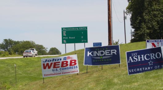 A portion of the sign clutter at a busy intersection.