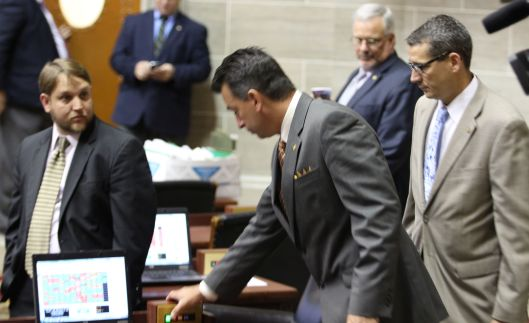 The final vote to override Governor Jay Nixon's veto of SB 509. Representative Jeremy LaFaver (D) (left) – bearing witness, Representative Keith English (center) – casting the 109th vote necessary for the override, and Representative Ron Hicks (r) (right) – his escort on and off the House floor. May 6, 2014.