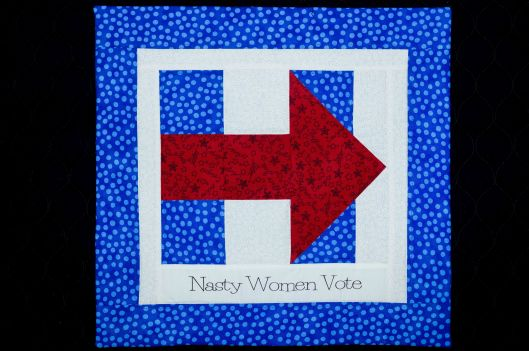 """Nasty Women Vote"" -  quilt block, machine pieced, machine quilted, 16.5 in.  x 16 in., Joan Ferguson."